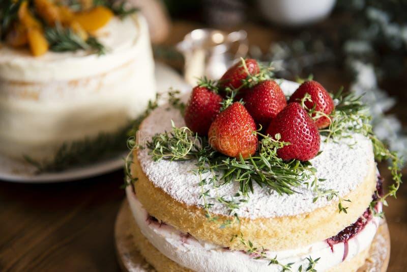 Layered cake with fresh cream and strawberries stock photos