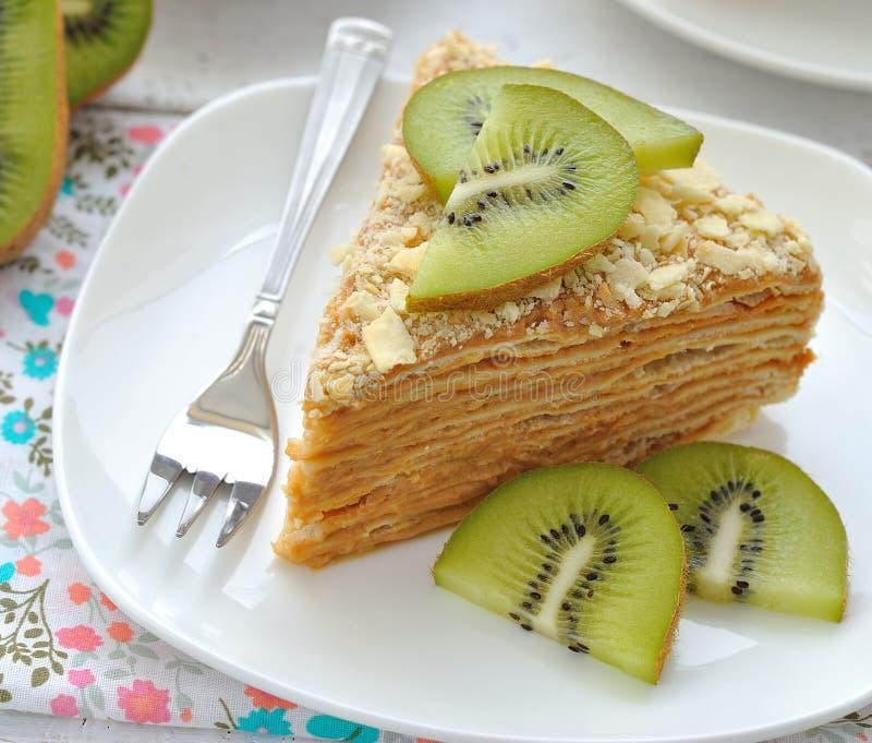 Layered cake with slices of kiwi fruit stock images