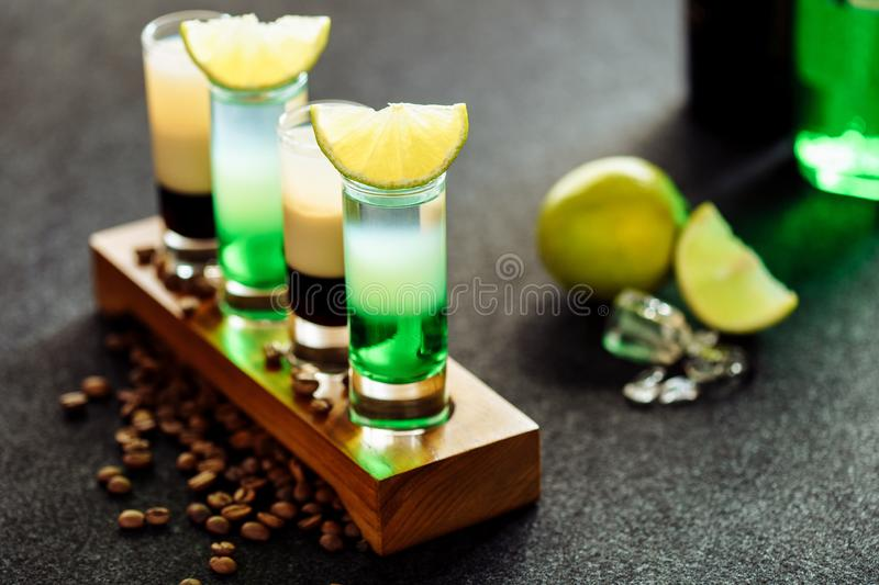 Layered Cocktail Drink Shot B52 Green Mexican Set. Alcohol Beverage with Brown and White Layer in Small Glass for Alcoholic Party. Colorful Sweet Strong Liquor royalty free stock photos