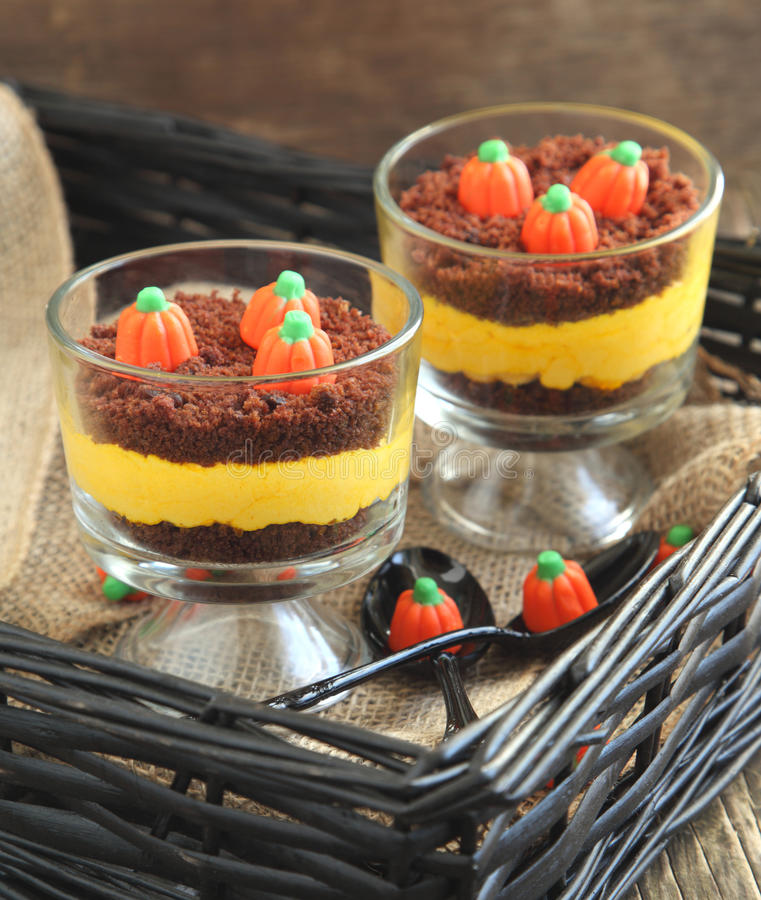 Layered cream cheese and brownie dessert for Halloween. Selective focus royalty free stock photo