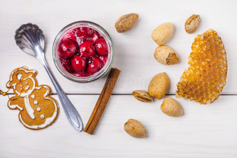 Layered dessert in a glass jar on a wooden table. royalty free stock images
