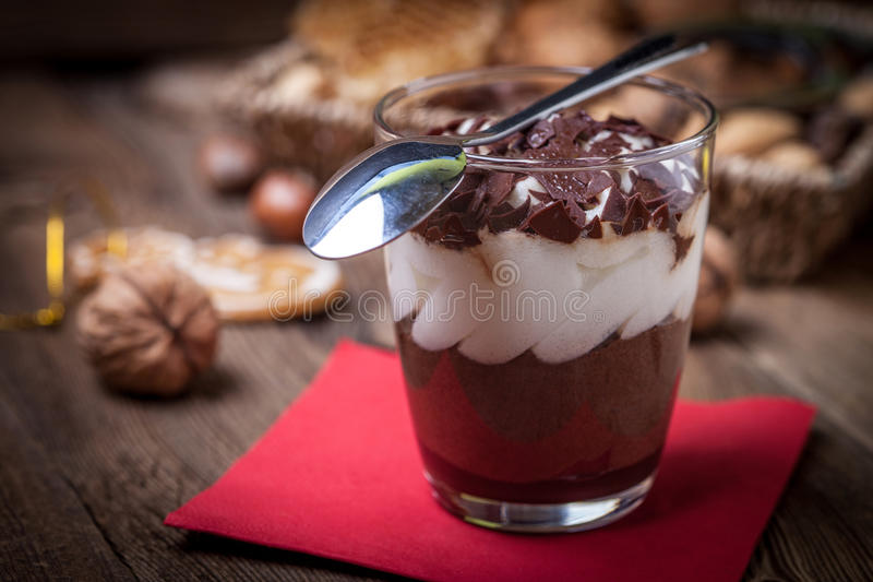Layered dessert in a glass on a wooden table. stock photos