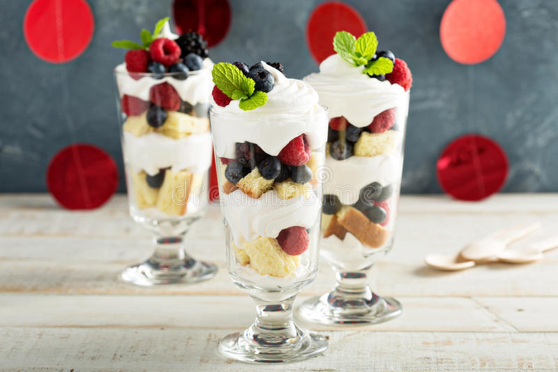 Layered dessert parfait with sweet bread and berries stock images