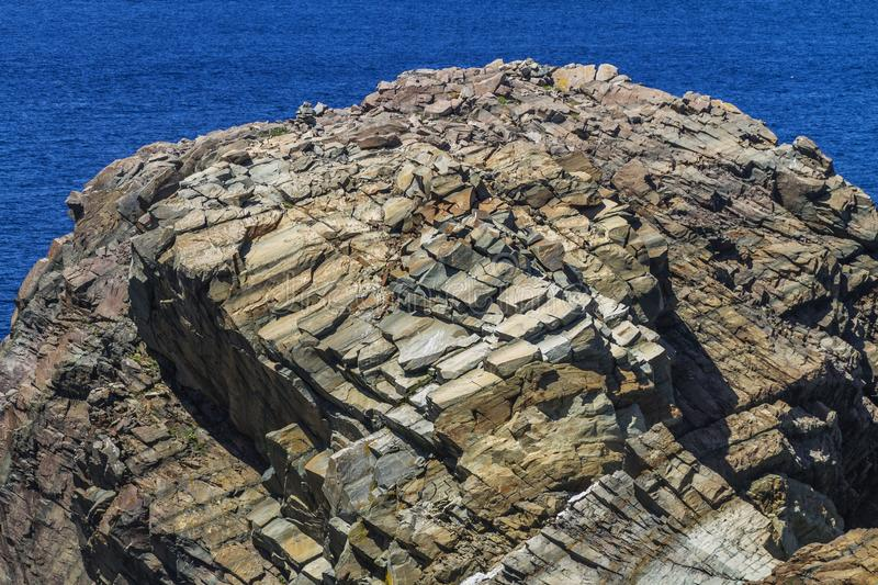 Layered and fractured rock on small island, Newfoundland royalty free stock images
