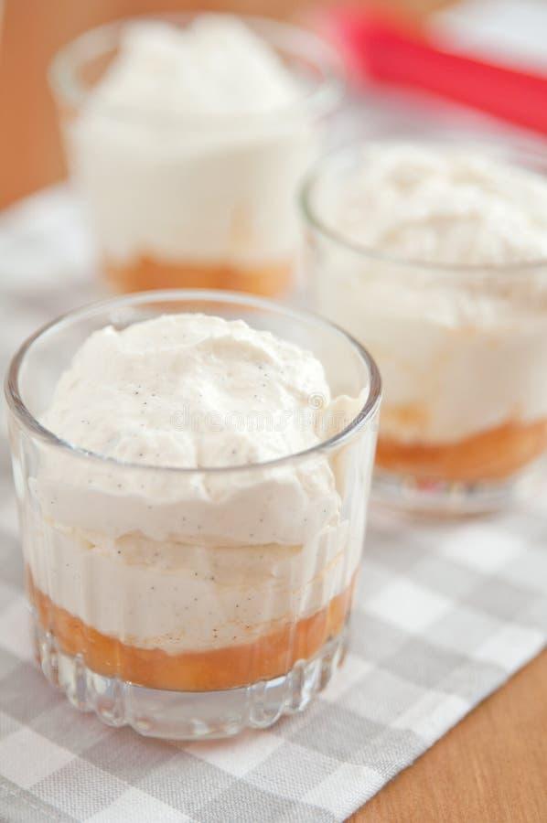 Layered Rhubarb Creme Dessert. With vanilla stock image