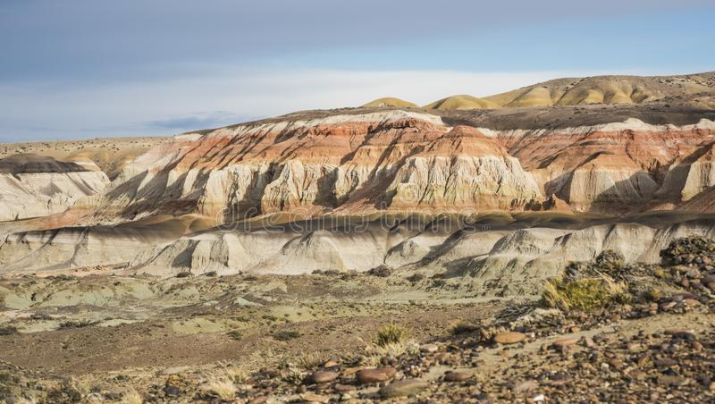 Petrified Forest Natural Reserve, Sarmiento, Patagonia. Layered sedimentary rocks in the Colorful valley of the Petrified Forest Natural Reserve, Sarmiento royalty free stock photography