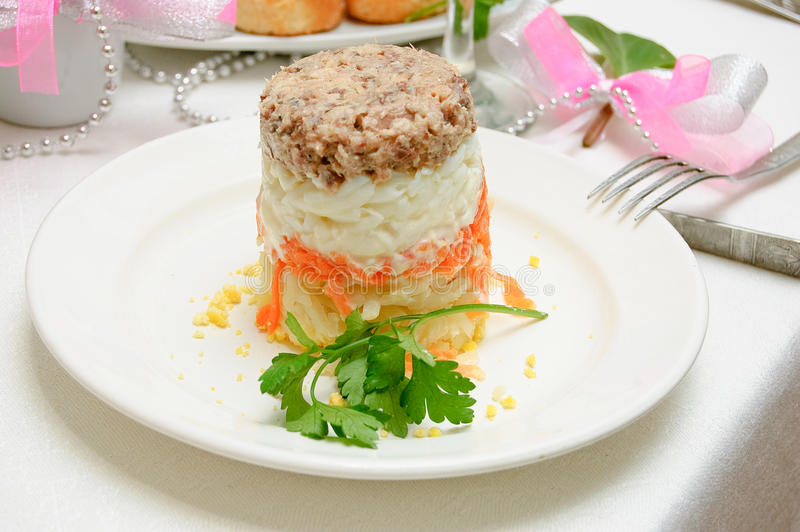 Layered vegetable salad. On the festive table royalty free stock photo