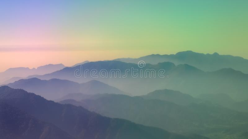 Layers of colorful mountains. Layers of mountains as seen from a domestic flight in Nepal. The dramatic RGB colors were the result sunrays directly falling on stock photos