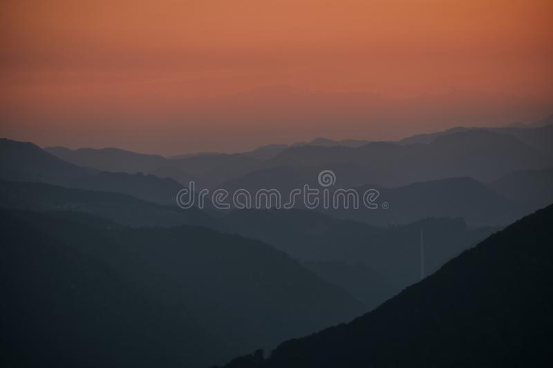 Layers of hills in the sunset with Trbovlje chimney. Slovenia stock photo