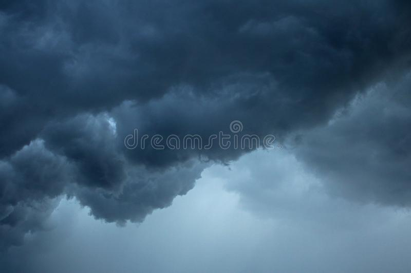 LAYERS OF LOW HANGING STORM CLOUDS royalty free stock images