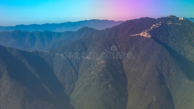 Layers of colorful mountains. Layers of mountains as seen from a domestic flight in Nepal. The dramatic RGB colors were the result sunrays directly falling on royalty free stock image