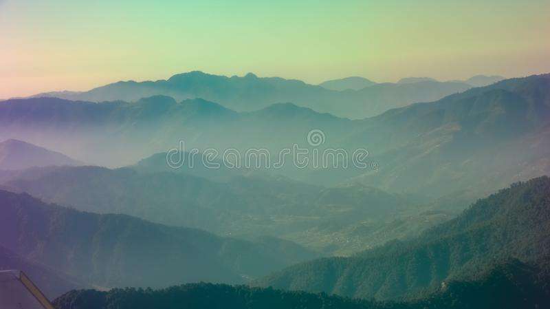 Layers of colorful mountains. Layers of mountains as seen from a domestic flight in Nepal. The dramatic RGB colors were the result sunrays directly falling on stock photography