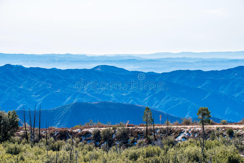 Layers of nature mountains and narrow road. royalty free stock images