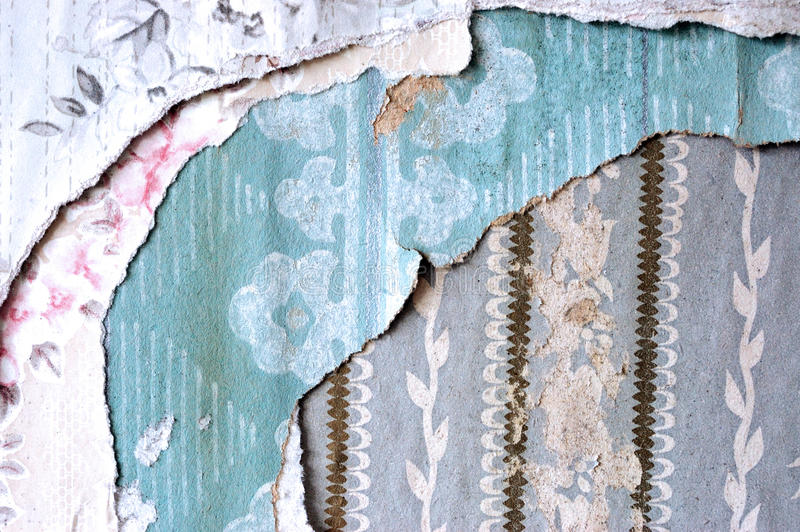 Layers of torn wallpaper. Several layers of old faded torn wallpaper stock photography
