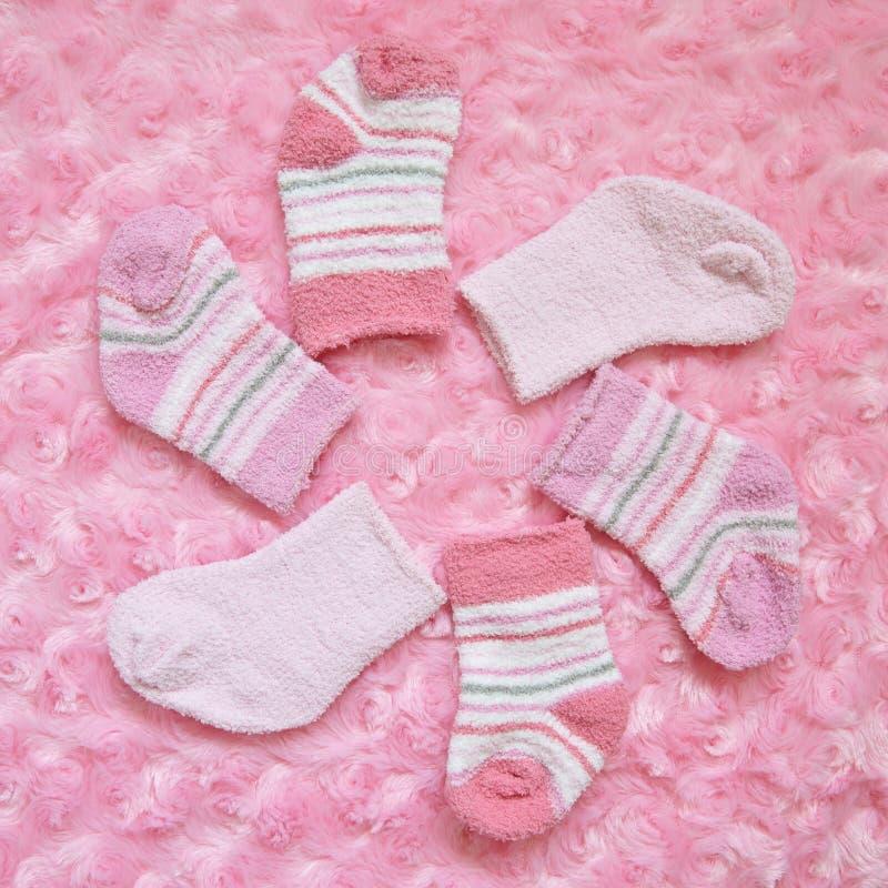Layette for newborn baby girl stock image
