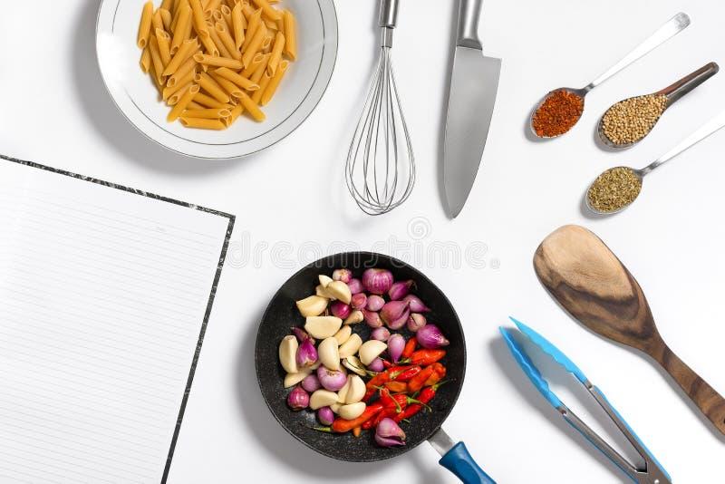 Layflat cooking image showing raw ingredients and cooking utensils. Layflat cooking image showing raw ingredients and cooking utensils on white background stock photo