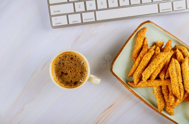 Layflat view to a with coffee and french fries computer keyboard royalty free stock image