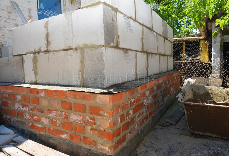 Laying autoclaved aerated concrete blocks, aac for house construction wall. Photo stock photos