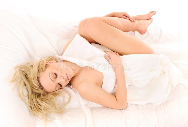 Laying in bed lovely woman. Bright picture of sleeping lovely woman stock images