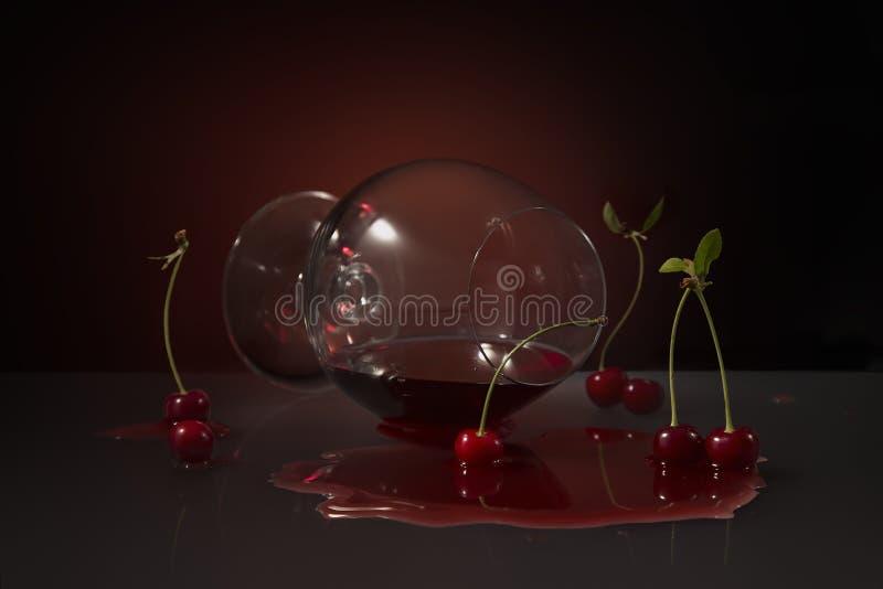 Laying cherry brandy glass stock photos