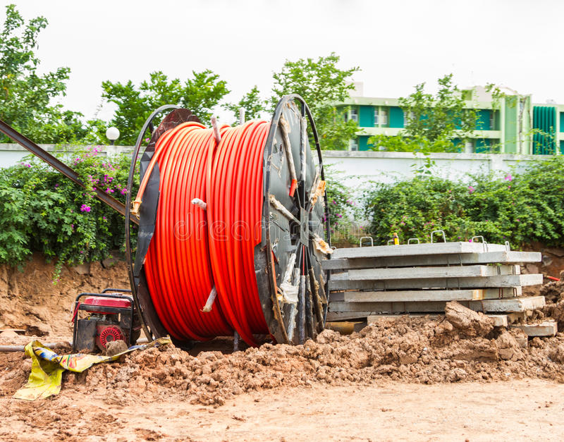 Laying of fiber optic cable. On background royalty free stock images