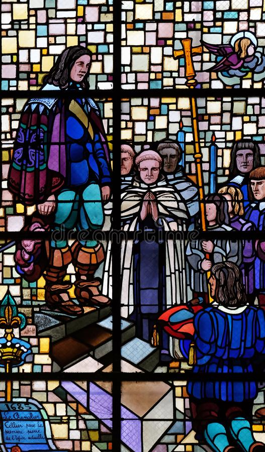 Laying of the foundation stone of the church in 1685 by the chancellor Michel Le Tellier. Stained glass window in Notre Dame des Blancs Manteaux in Paris stock photography