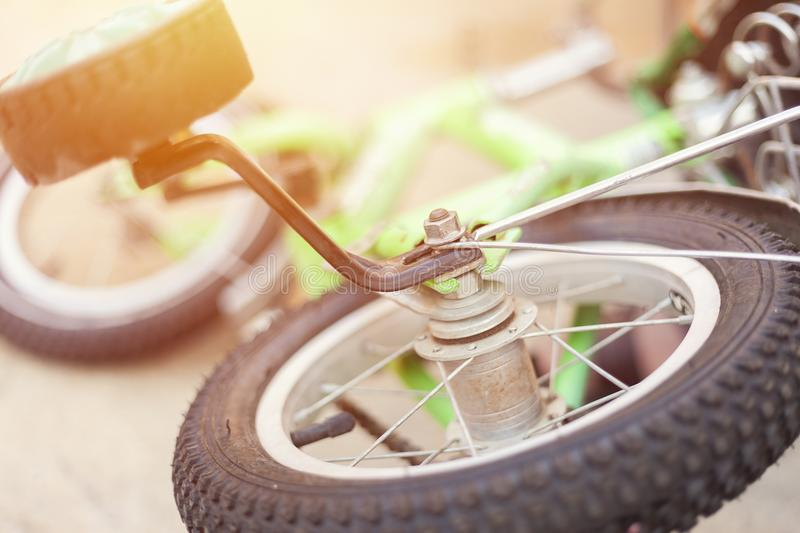 Laying on the ground kids bicycle. Close-up photo. Of tires royalty free stock photos
