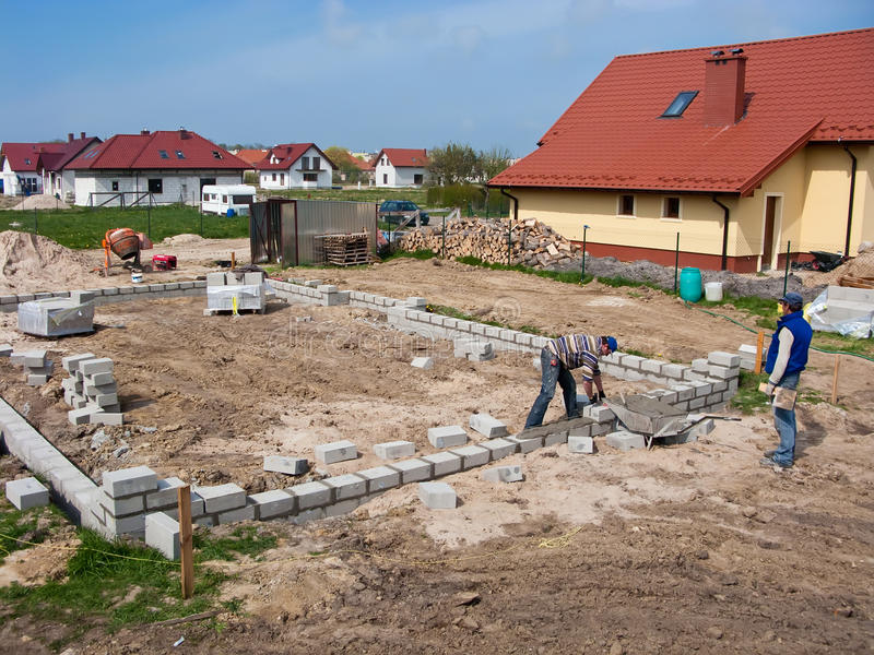 Laying house foundations stock photo
