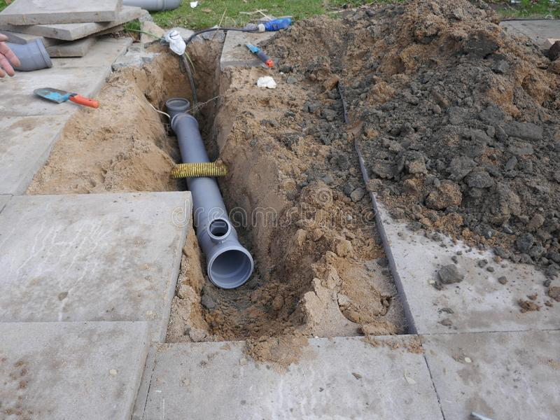 Laying and installation of a sewer pipe royalty free stock image