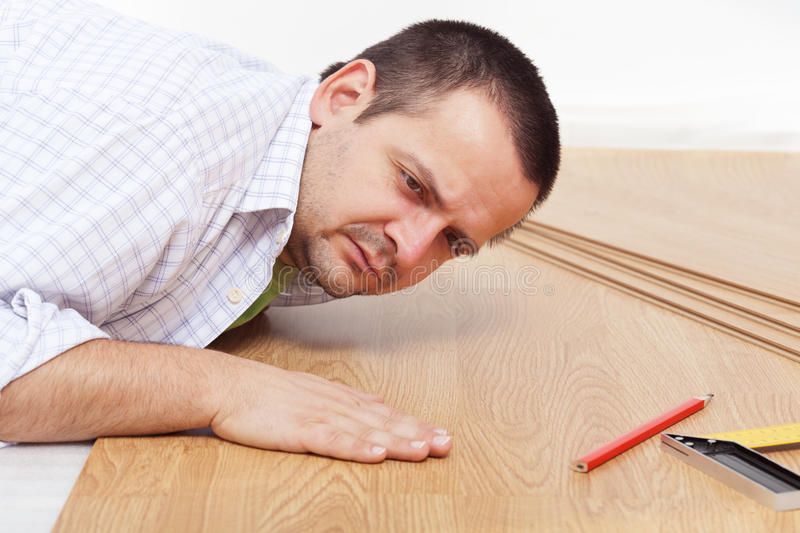 Laying Laminate Flooring At Home Stock Photo