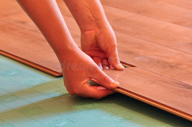 Laying laminate flooring royalty free stock photos