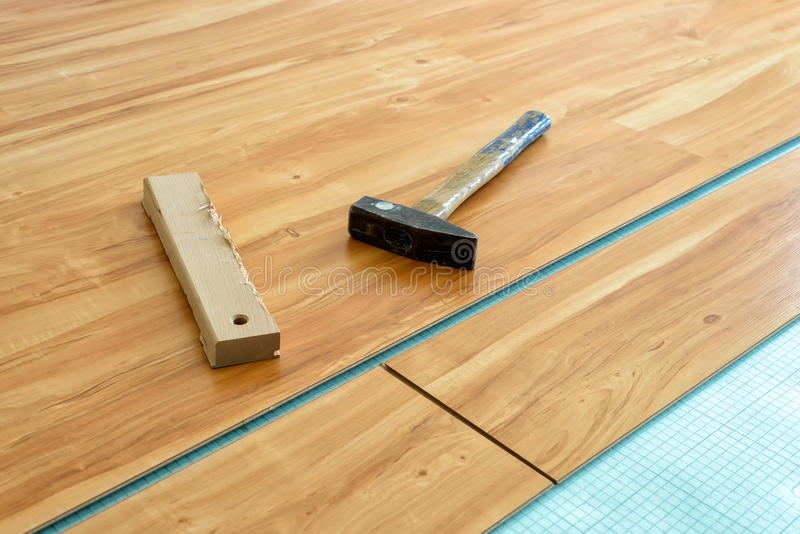 Laying of parquet floor. With tools in a new house royalty free stock photos