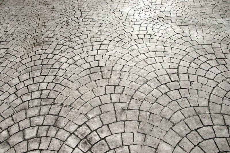 Laying patio bricks. Install patio bricks in a semicircular pattern (Pedestrian road stock photos