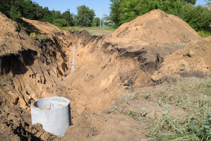 Laying of sewer pipes. Laying of underground utilities to the residential home stock photo