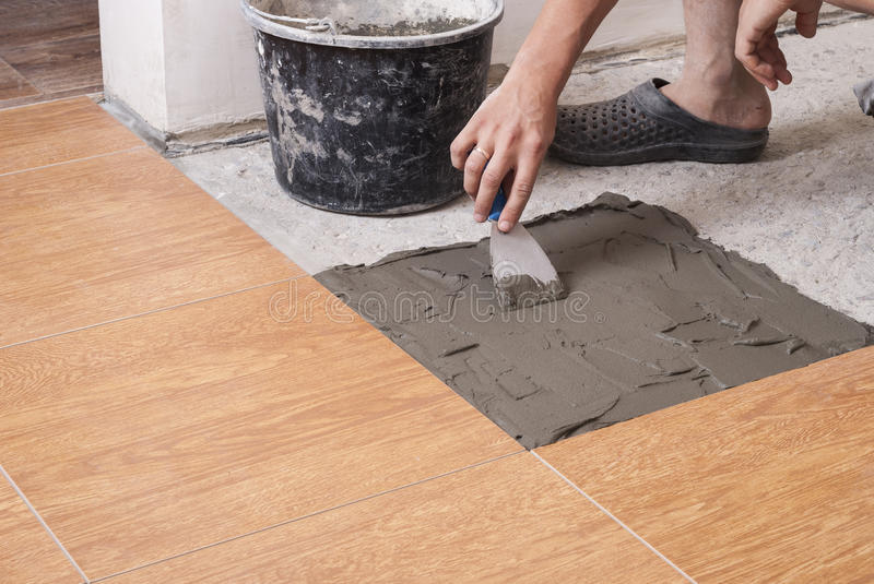 Laying Tiles On The Floor Stock Image Image Of Spacer 77223043