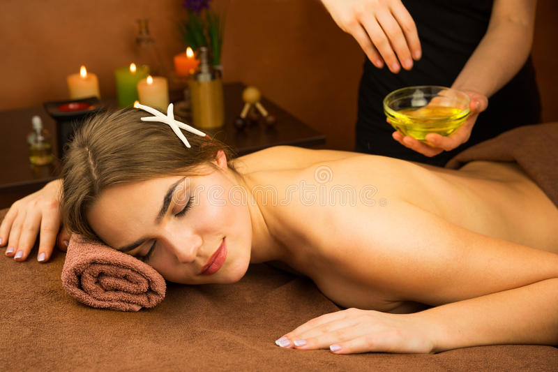 Laying woman getting laser and ultrasound facial therapy royalty free stock photography