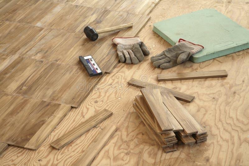 Laying wood flooring royalty free stock image