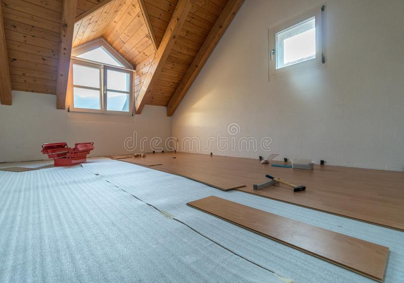 Laying wooden floor during renovations. With tools and a red toolbox royalty free stock photos