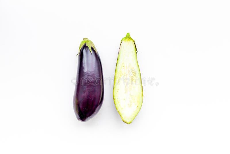 Layout of fresh sliced eggplant on white background top view copy space. Layout of fresh sliced eggplant on white background top view stock photo