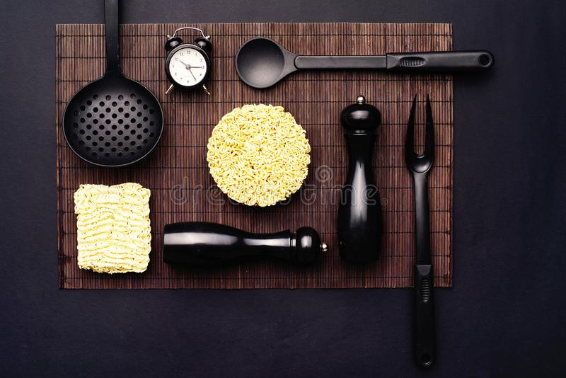 Layout Of Kitchen Accessories And Instant Noodles On A Black Background Top View Stock Image Image Of Austerity Preparation 109296509