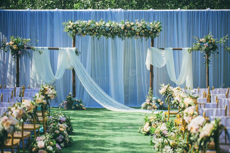 Layout of outdoor lawn wedding scene. We can see the photos of the main site of an outdoor wedding, white cloth for the background, symbolizing the sanctity of stock photography
