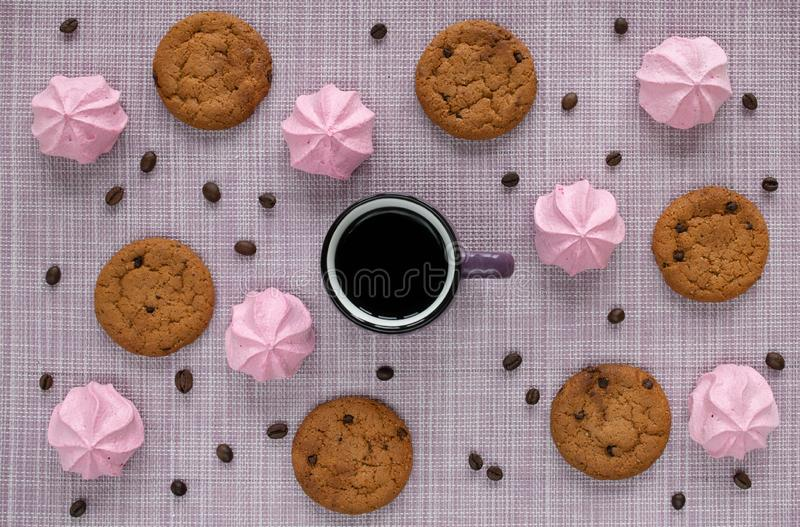 Layout on a woven napkin with oatmeal cookies, a cup, coffee beans and pink marshmallow stock photography