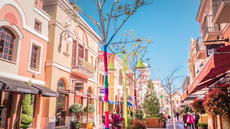 The Main Street at Laz Rozas shopping village near Madrid, Spain. Madrid / Spain - 03 30 2019: Las Rozas village is an open-air shopping village with royalty free stock images