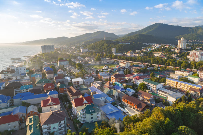 LAZAREVSKOE, SOCHI, KRASNODAR REGION, JULY 5, 2017: View of the beach, amusement park and center of Lazarevskoe city, Sochi, at su. Nset in summer royalty free stock image