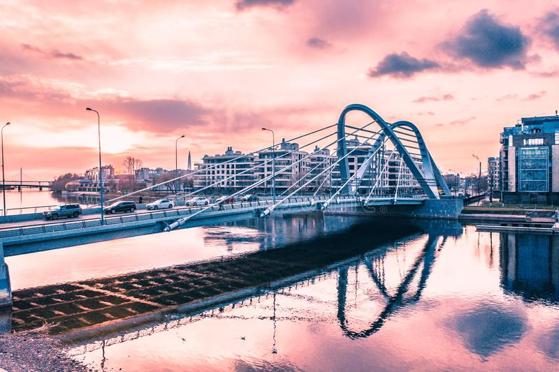 Lazarevsky Bridge in St. Petersburg. Cable-stayed Lazarevsky Bridge in Sant Petersburg a sunset, Russia royalty free stock photography
