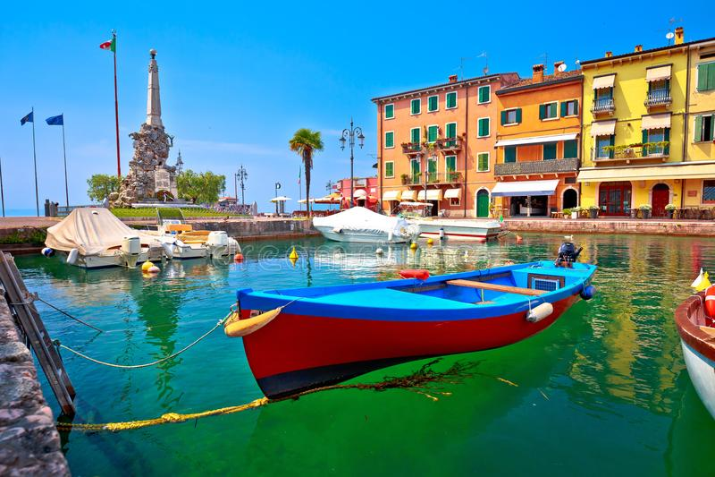 Lazise turquoise harbor and Lago di Garda view. Veneto region of Italy royalty free stock image