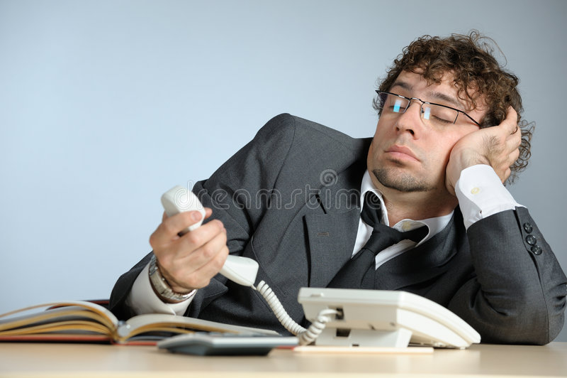 Lazy businessman stock photography