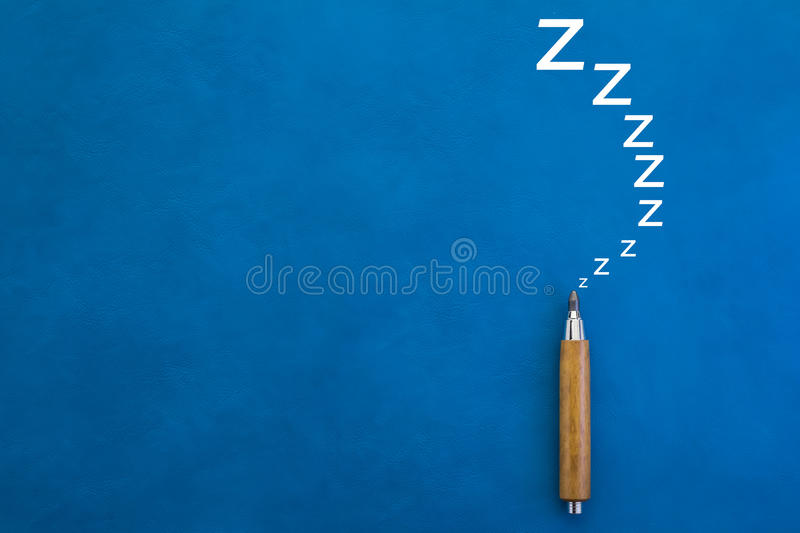 Lazy concept with pencil on blue background stock photo