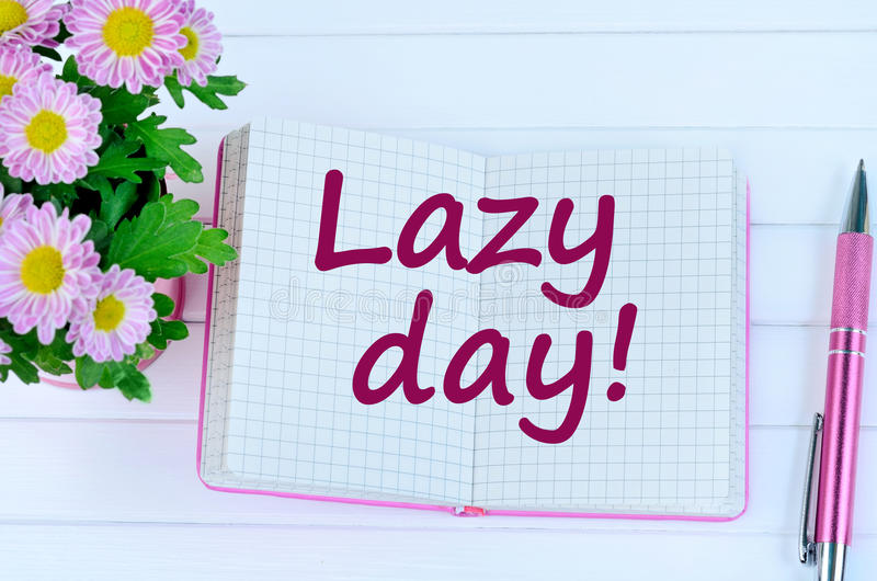 Lazy day words on notebook. Page royalty free stock image