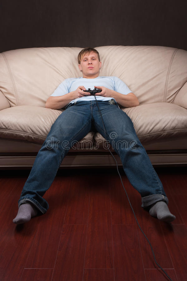 Lazy gamer royalty free stock photos